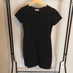 Black, fitted, mini dress.